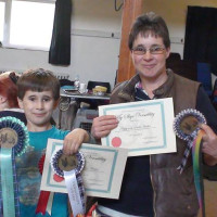 Thomas and Linda Hasker with their Versatility and Junior Handling Awards